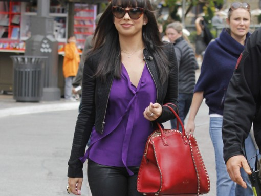 Cheryl Burke brightens up with a red Valentino bag