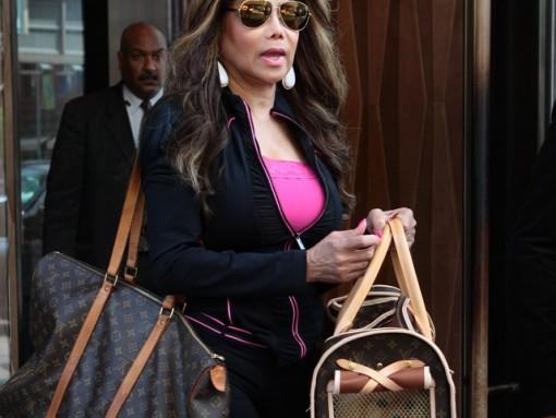 LaToya Jackson totes her furry friend in Louis Vuitton
