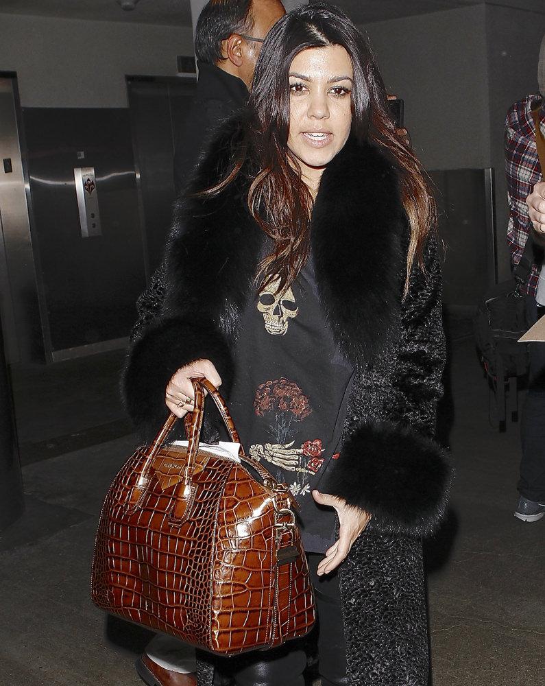 Khloe and Kourtney Kardashian were seen arriving on a flight at LAX
