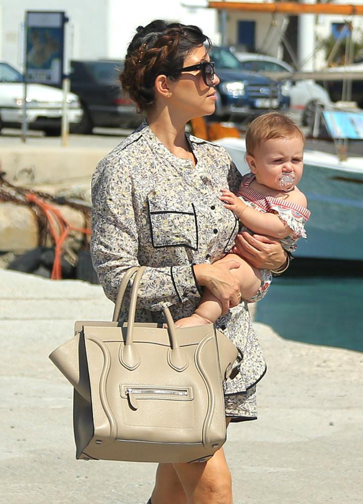 Khloe Kardashian and Kourtney Kardashian carry her children to a yacht ride in Mykonos, Greece