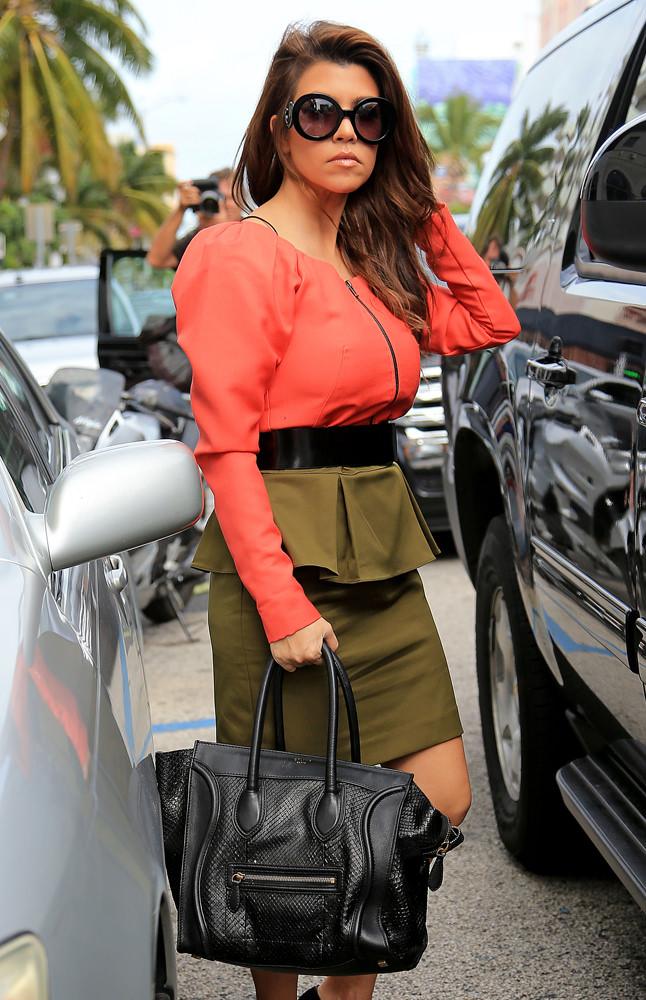 Kourtney Kardashian and Kim Kardashian go shopping at Sisley in South Beach, FL