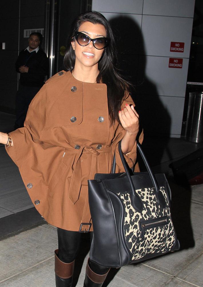 Kourtney Kardashian and sister Khloe Kardashian touch ground at JFK airport in New York.