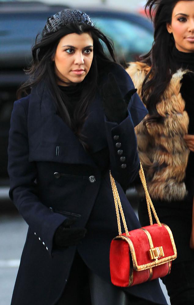 Kim Kardashian and Kourtney Kardashian board the circle line boat to go to Statue of Liberty, NYC