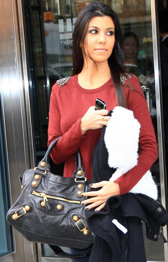 Kourtney Kardashian heads out of her hotel in NYC