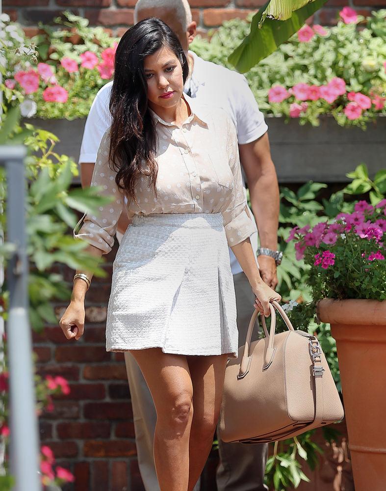 Kim, Kourtney and Khloe Kardashian, Kris Jenner and Scott Disick take a walk in downtown Southampton, NY