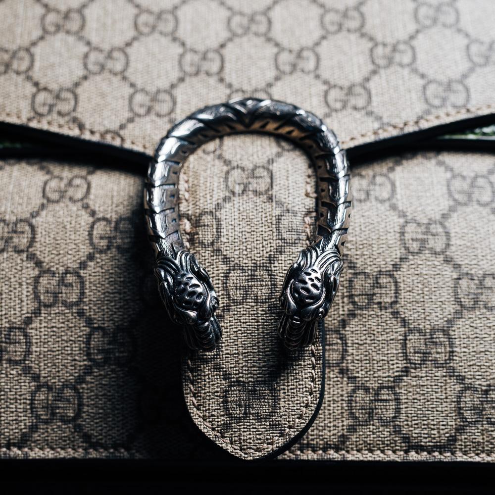 Gucci Dionysus GG Supreme Python Shoulder Bag, $2,900 via Gucci
