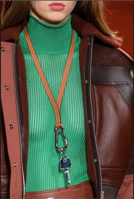 """""""Key detail. A wrist strap with a snap hook fastener."""""""