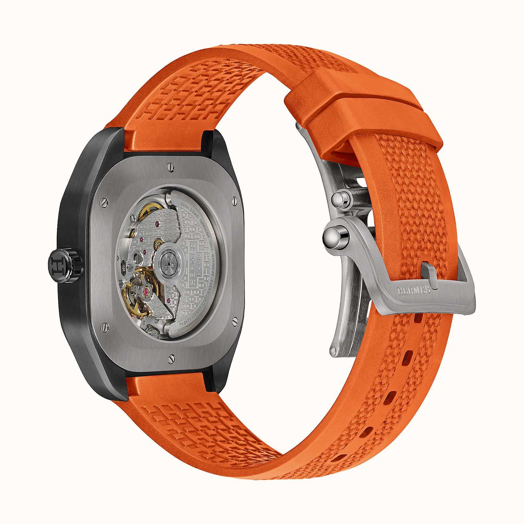 Contrasting strap on the duo-tone titanium H08. Photo via Hermes.com