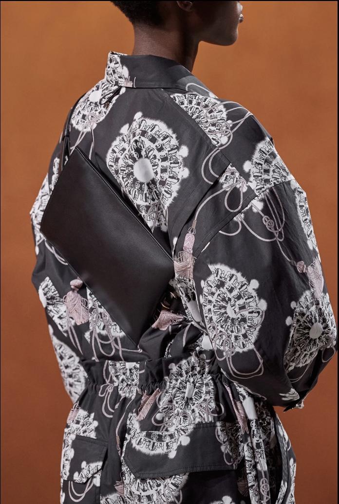 Look 39: a pretty print and a back sling bag. Photo via Vogue.com